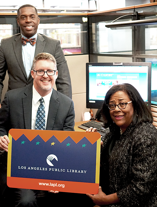 Workforce Development Specialist Johnathan Davis, City Librarian John Szabo and EWDD Gen Manager Jan Perry promote EWDD Job Portal and Library Card Sign-up Month