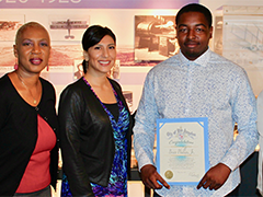 EWDD Youth Operations Director Brenda Anderson, YOM Watts Case Managers Teresa Cordero and Socrates Garay celebrate HireLAX graduate Brian Phillips, Jr (center)