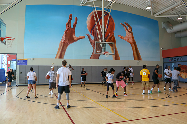 YouthSource kids run basketball drills with former LA Laker Metta World Peace and a group of his coaches