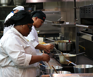 LAHTA Culinary Apprenticeship student learns how to prepare a delicate sauce