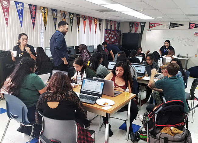 Para Los Niños staff helping youth participants with financial aid applications for college