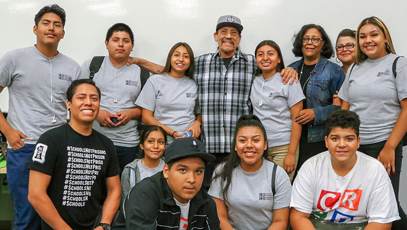 Actor Danny Trejo (center) with YouthSource Center participants from Community for Responsible Community Development and EWDD General Manager Jan Perry (third from right)