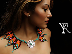 woman wearing a signature necklace from the Yiceth Rico jewelry line