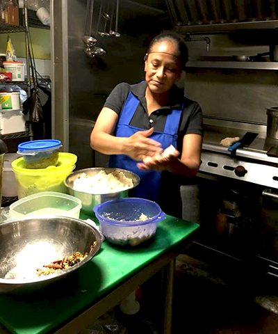 Doña Imelda Tecualpetla in the kitchen of her restaurant, La Union, making Pupusa, a traditional El Salvadoran dish