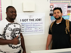 "(left to right) Kevin White and Gabriel Celis celebrate their new employment under the ""I Got the Job"" sign at the Vernon-Central/LATTC WorkSource Center."