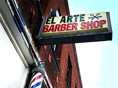 Exterior of El Arte Barbershop in South Los Angeles