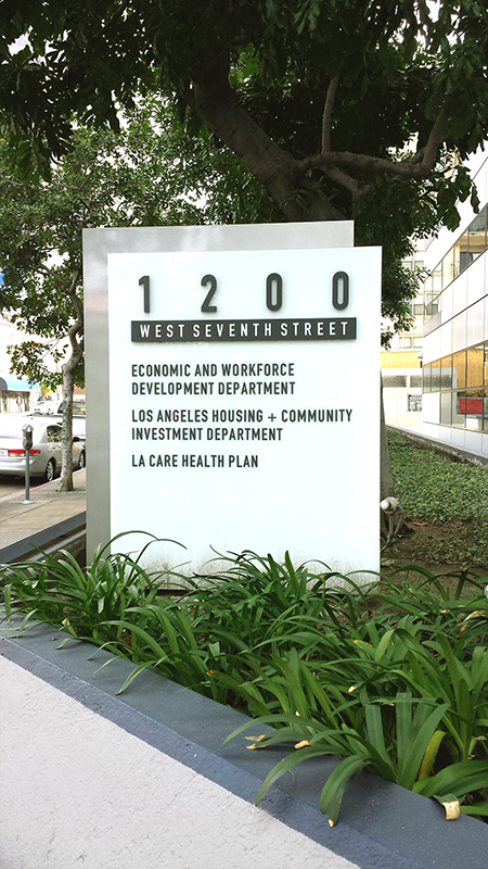 EWDD west facing street sign with address, 1200 West 7th Street, Los Angeles