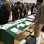 Job seekers stop at the Southeast Los Angeles WorkSource booth run by EWDD partner Watts Labor Community Action Committee (WLCAC) at the Fourth Homeless Services Job Fair on Thursday, January 17, 2019