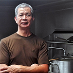 Restauranteur Jin Huang in the kitchen of his second Asian Kings restaurant in the Mid-Wilshire district of Los Angeles