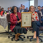 EWDD General Manager Jan Perry (center left) holds up a certificate of appreciation from Mayor Eric Garcetti presented by Chief of Staff Ana Guerrero (center right) at her going away festivities on December 18, 2018.